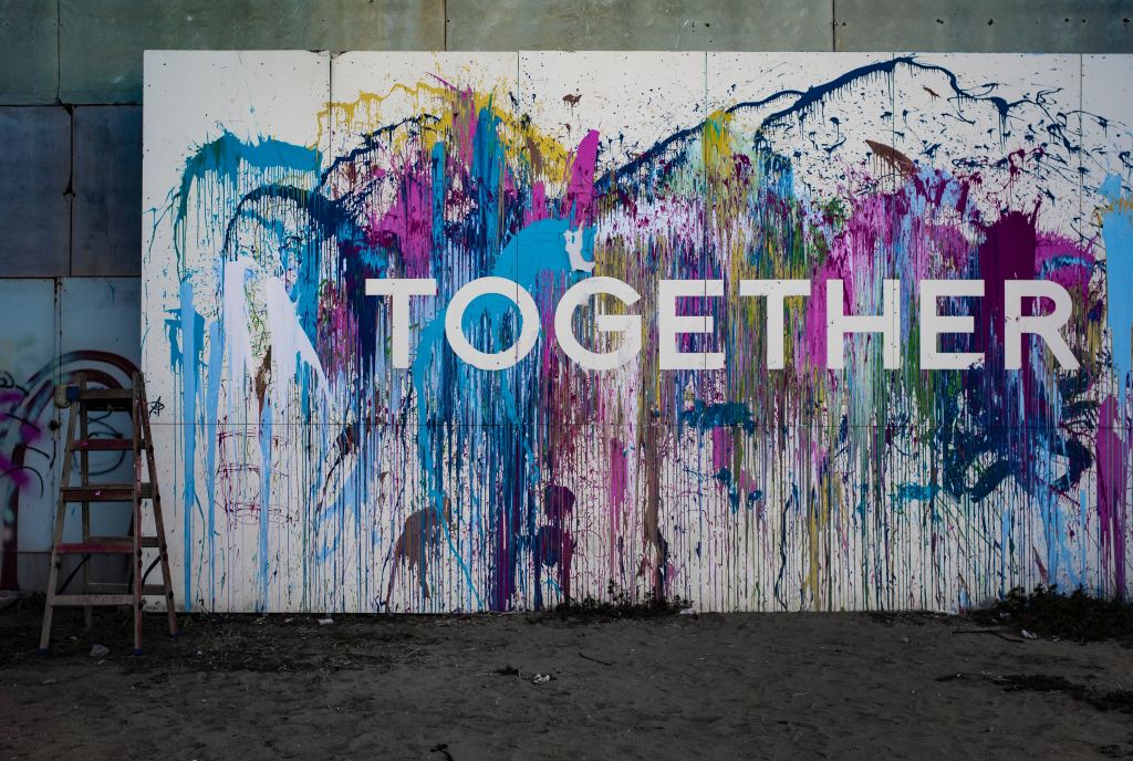 "Colourful mural on wall, saying ""TOGETHER""."