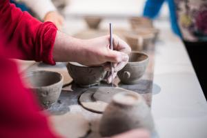 Potter incising clay