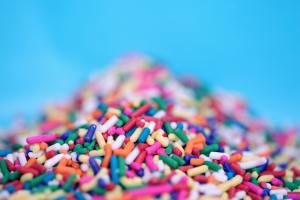 Pile of cake brightly multi-coloured cake sprinkles